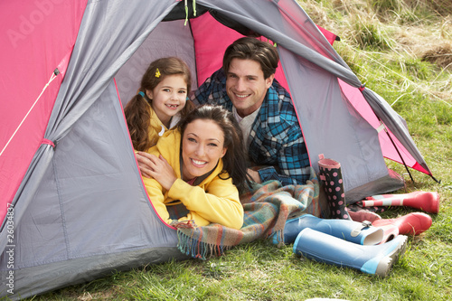 Poster Camping Young Family Relaxing Inside Tent On Camping Holiday