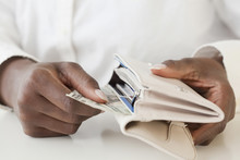 African Woman Taking Money Out Of Wallet