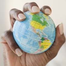 African Woman Holding Globe In Hand