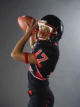 Mixed Race Quarterback Ready To Throw Football
