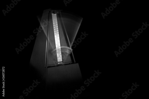 Metronome Ticking with Black Background Wallpaper Mural