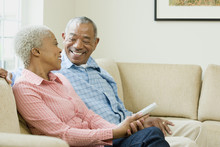 African Couple Watching Television