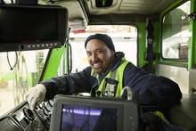 Pacific Islander Man Driving Garbage Truck