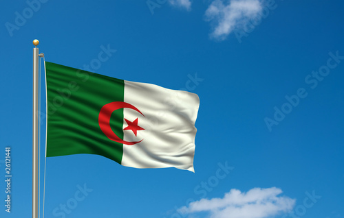 Flag of Algeria waving in the wind in front of blue sky