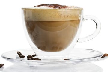 Fototapeta Kawa cappuccino mit schokopulver in einer glastasse von der seite
