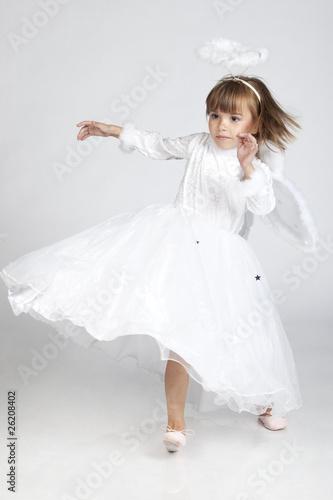 Платно Cute little girl dressed as an angel ready to fly
