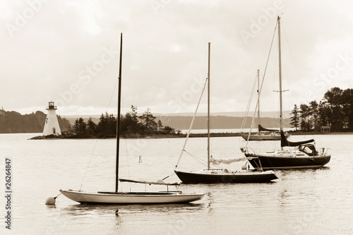 Fotografie, Obraz  Boats and lighthouse on Bras D'Or lake, Cape Breton, Nova Scotia
