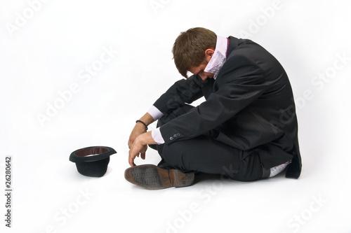 Photo  Bankkrupt businessman, beggar