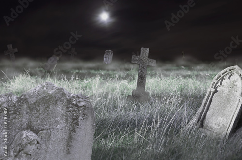 Foto auf Gartenposter Friedhof Scary cemetery at night