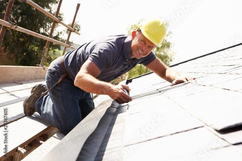 Roofer Working On Exterior Of New Home Fototapeta