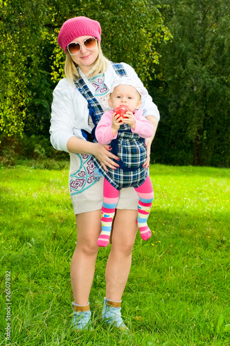 фотография  mother with child in baby carrier