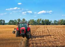 Tractors Working On Field