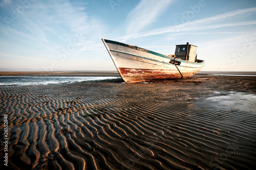 Aground boat on the beach Wallpaper Mural