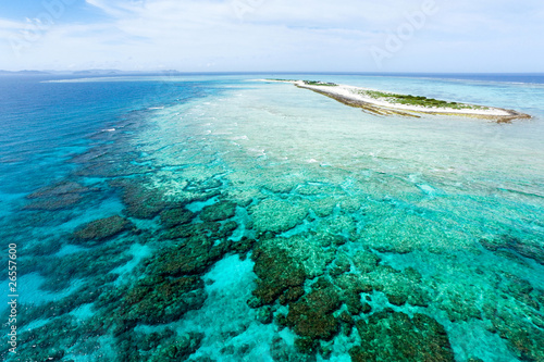 Aerial view of deserted tropical island on coral reef, Okinawa