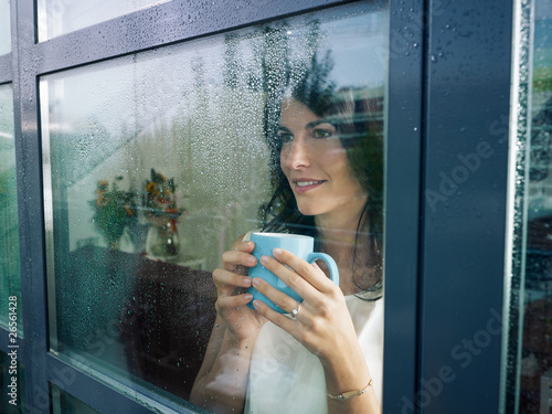 Fotomural woman staring at the window