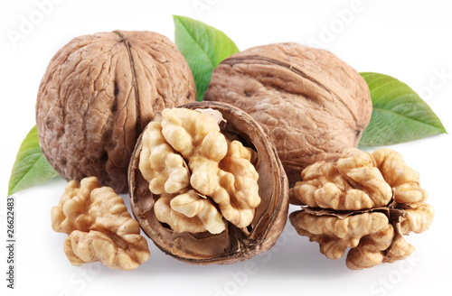Fotografía  Walnuts with leaf isolated on a white background.