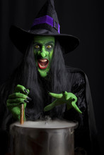Scary Witch Stirring A Smoking...
