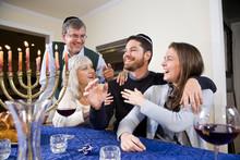 Jewish Family Celebrating Chanukah