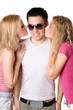 Two pretty blonde kissing young man