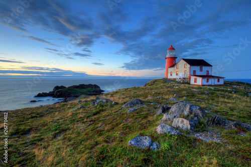 Poster de jardin Canada Rocky coastline with lighthouse.