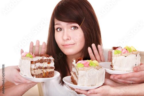 Valokuva  Girl refuse to eat pie. Isolated.