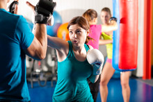 Female Kick Boxer With Trainer...