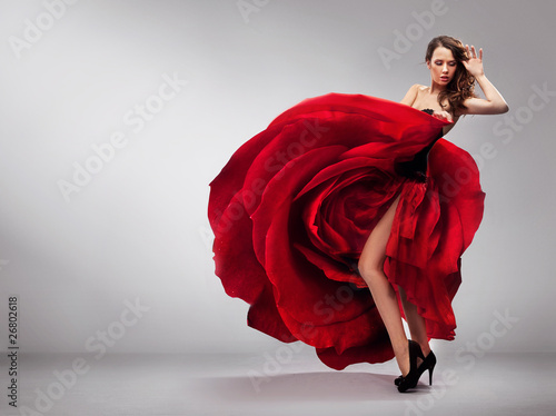 Obraz Beautiful young lady wearing red rose dress - fototapety do salonu