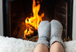 canvas print picture - Children's feet are heated in the fireplace