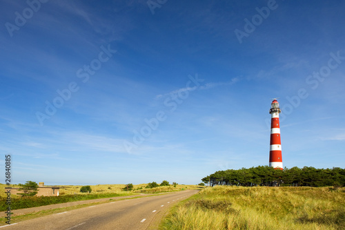 Fotobehang Vuurtoren lighthouse in landscape