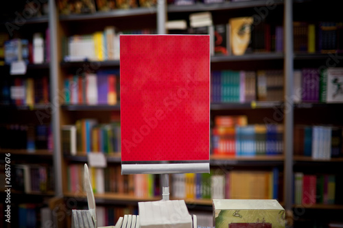 Photographie Red ad space in bookstore - many books in the background