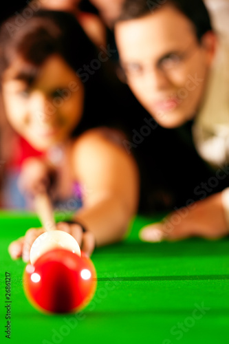 Fotografie, Tablou  Couple playing billiards