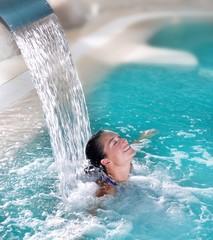 Fototapeta spa hydrotherapy woman waterfall jet