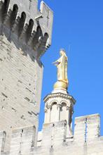 Goloden Statue And Tower Of Av...
