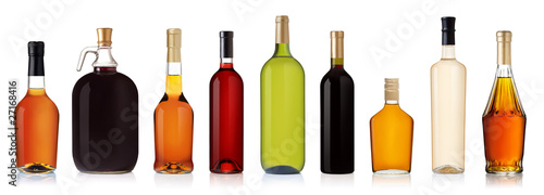 Photo Set of wine and brandy bottles.