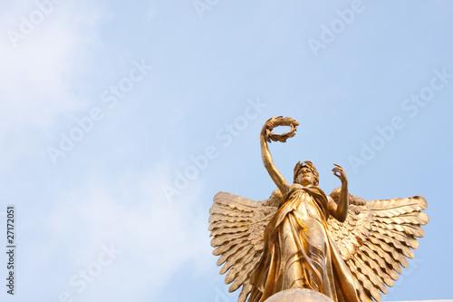 Fotografija  Goddess statue in the sky.