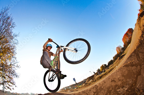 boy going airborne with his  bike
