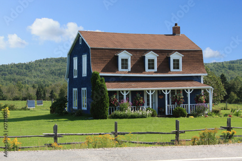 Farmhouse next to the road in Quebec, Canada Wallpaper Mural