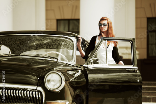 Young woman with a retro car.