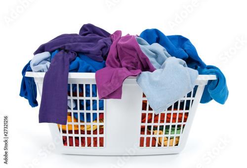 Fotografie, Obraz  Colorful clothes in laundry basket. Blue, indigo, purple.