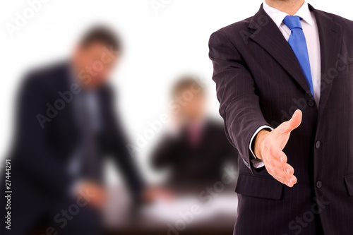 Fototapety, obrazy: A businessman with an open hand ready to seal a deal at the offi