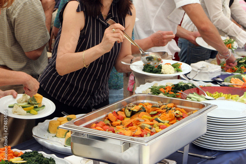 Fotografie, Obraz  catering service, people self serving on a buffet