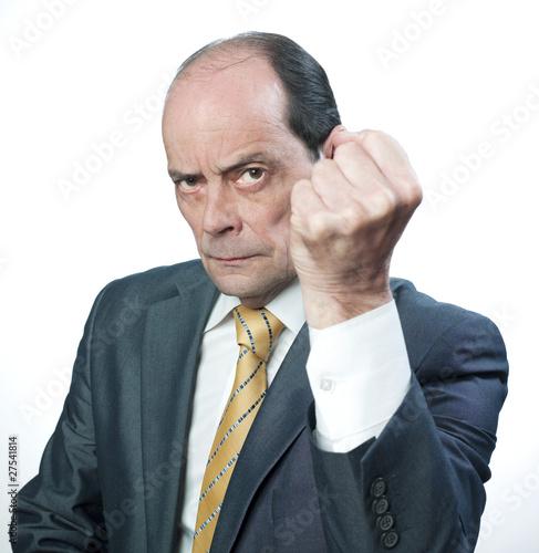 Valokuva  business man senior montrant le poing