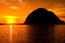 Morro Rock And Sail Boats During A Sunset