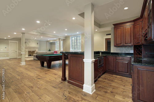 Photo Basement with fireplace and bar