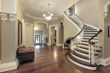Foyer With Curved Staircase