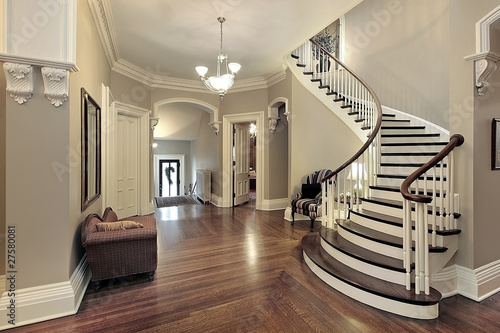 Photo Foyer with curved staircase