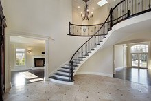 Foyer With Circular Staircase