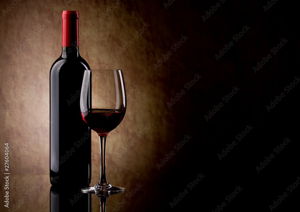 bottle with red wine and glass and grapes