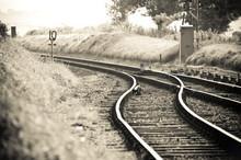 Train Tracks Merging On A Vint...