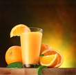 Oranges and glass of juice.